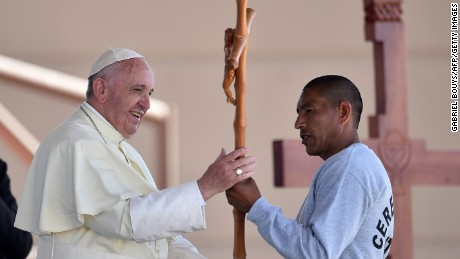 Pope Francis receives a cross made by an inmate at the CeReSo n. 3 prison in Ciudad Juarez, Mexico, Wednesday, Feb. 17, 2016. The pontiff is wrapping up his trip to Mexico on Wednesday with a visit in the prison, just days after a riot in another lockup killed 49 inmates, and a stop at the Texas border when immigration is a hot issue for the U.S. presidential campaign.  (Gabriel Bouys/Pool photo via AP)