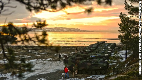 """U.S. Marine Corps amphibious assault vehicles before a public """"splash"""" demonstration in the Trondheim Fjord in Norway, Jan. 10. The partnership between the Norwegian military and U.S. Marines enables NATO to pivot toward crisis by alleviating logistics requirements to support a broad-spectrum military operations."""