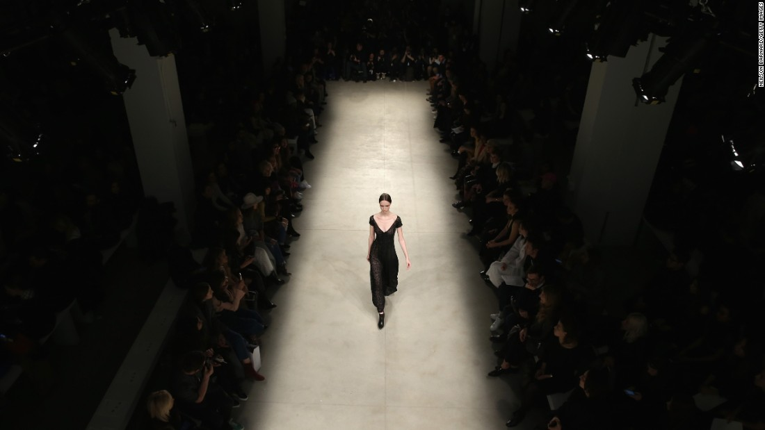 A model walks the runway wearing Yigal Azrouel's fall 2016 line. An Israeli-American designer, Azrouel launched his first line in New York almost two decades ago.