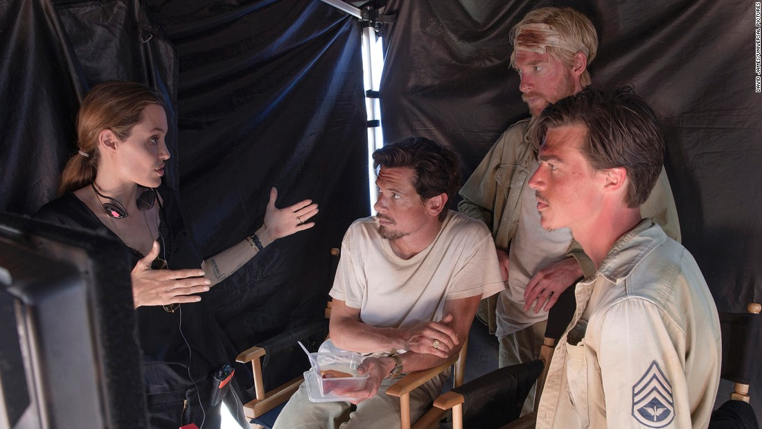 """Angelina Jolie has gone from actress to director with such films as 2014's """"Unbroken,"""" the story of Olympian Louis Zamperini, which brought in $115 million at the box office. (The film co-starred Jack O'Connell, center, Domhnall Gleeson and Finn Wittrock.) The most rewarding part: """"Sitting at Louie's bedside in the hospital and revisiting chapters of of his life through our film, while witnessing him preparing to leave his life behind,""""Jolie said."""