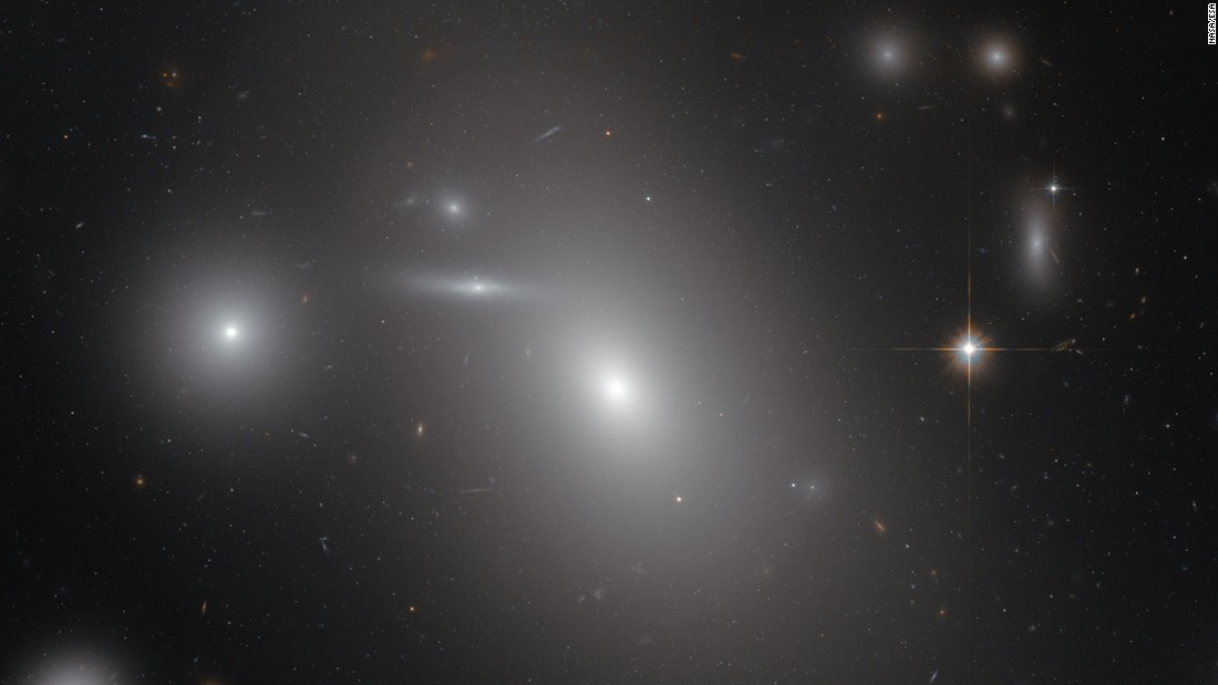This image shows the elliptical galaxy NGC 4889, deeply embedded within the Coma galaxy cluster. There is a gigantic supermassive black hole at the center of the galaxy.