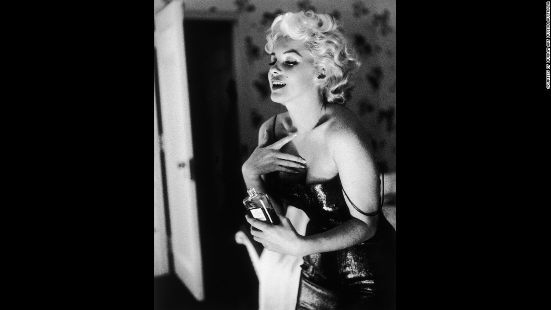 """The photographer Ed Feingersh was sent by Redbook magazine to follow Monroe through her daily routine in 1955. She's depicted here holding a bottle of Chanel No. 5. The late actress helped fuel the popularity of the fragrance when she told press: """"What do I wear to bed? Why, Chanel No. 5 of course"""""""