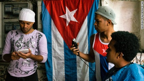 Cuban citizens gained access to Wifi for the first time in June 2015 when the state telecommunication company ETECSA began installing 35 Wifi hotspots in the parks of main cities. Inside a private barber shop, close to the Parque Central, young boys are using the social networks and are exploring internet.