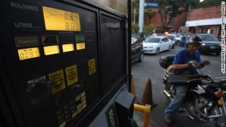 A motorcyclist waits to buy gas in Caracas on February 17, 2016. Venezuela's President Nicolas Maduro said Wednesday he would raise the price of gasoline for the first time in 20 years, as he faces growing pressure to ease an economic crisis. Maduro said in a televised address he would raise the pump price of premium gasoline from its current super-low level of $0.01 to the equivalent of $0.95 at the fixed official exchange rate, in a country where citizens are struggling with soaring inflation. AFP  PHOTO/JUAN BARRETO / AFP / JUAN BARRETO        (Photo credit should read JUAN BARRETO/AFP/Getty Images)