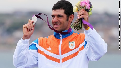 Pavlos Kontides of Cyprus celebrates winning the silver medal in the Men's Laser Sailing on Day 10 of the London 2012 Olympic Games at the Weymouth & Portland Venue at Weymouth Harbour on August 6, 2012 in Weymouth, England. It is Cyprus's first ever Olympic medal.