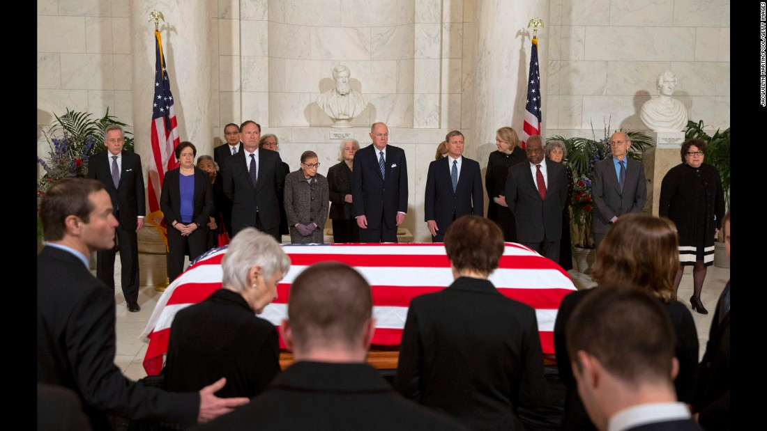 "U.S. Supreme Court justices attend a private ceremony in the court's Great Hall as the body of Justice Antonin Scalia <a href=""http://www.cnn.com/2016/02/19/politics/supreme-court-antonin-scalia-memorial/index.html"" target=""_blank"">lies in repose</a> on Friday, February 19. Facing the camera, from right, are justices Sonia Sotomayor, Stephen Breyer, Clarence Thomas, John Roberts, Anthony Kennedy, Ruth Bader Ginsburg, Samuel Alito and Elena Kagan."