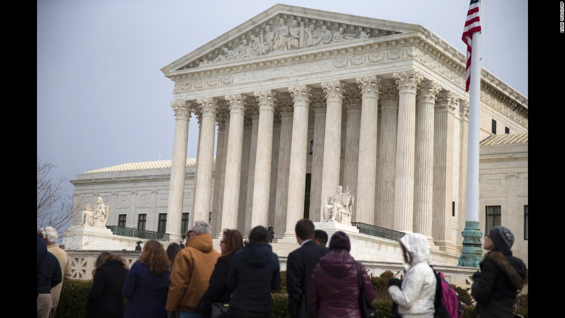 People wait in line outside the Supreme Court on February 19.