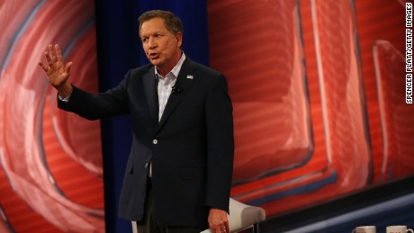 Republican presidential candidate, Ohio Gov. John Kasich answers a voter's question in a CNN South Carolina Republican Presidential Town Hall with host Anderson Cooper on February 18, 2016 in Columbia, South Carolina.