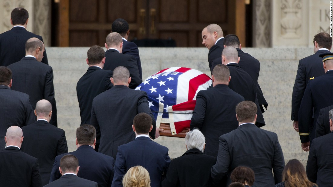 The casket containing Scalia's body arrives at the Basilica of the National Shrine of the Immaculate Conception.