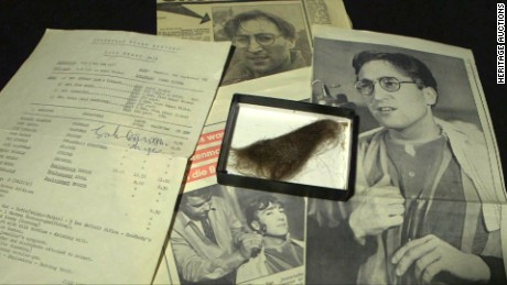 A lock of John Lennon's hair sold Saturday for $35,000. Included were two vintage newspapers and a signed call sheet.