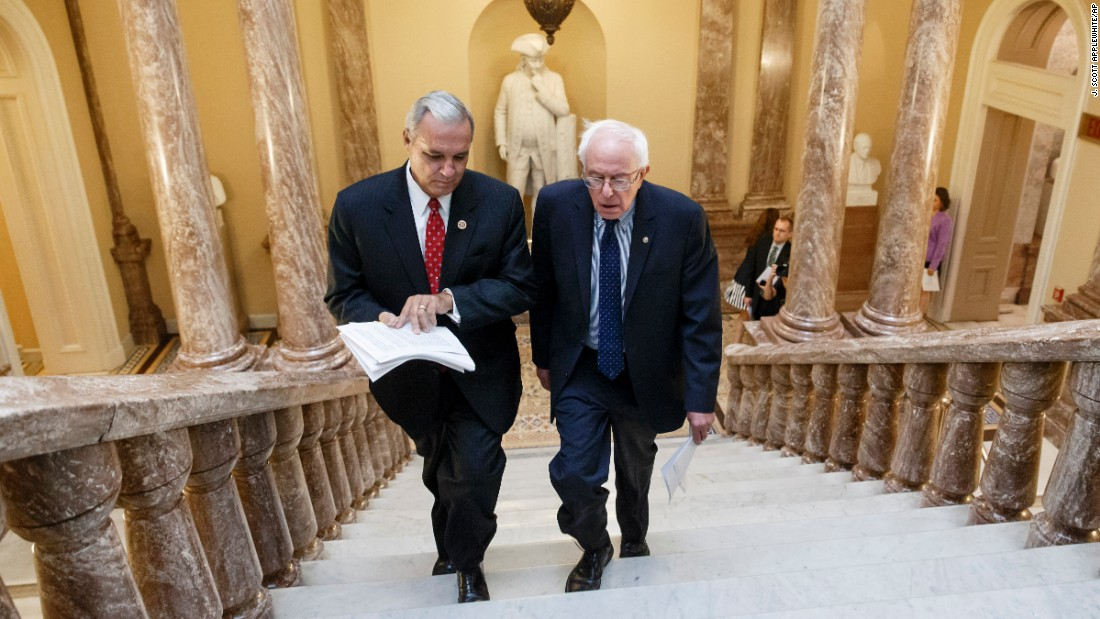 Sanders and U.S. Rep. Jeff Miller, chairman of the House Committee on Veterans' Affairs, walk to a news conference on Capitol Hill in 2014. Sanders was chairman of the Senate Committee on Veterans' Affairs.