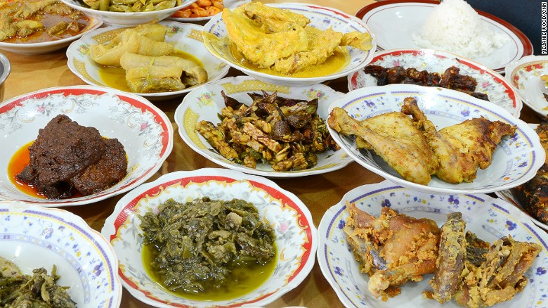 Nasi padang is a feast of dozen dishes stacked up on your table, tp go with a plate of steamed rice. Back off, Singapore. It's ours.