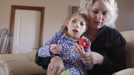 Gwen Hartley with her daughter Claire, who has microcephaly.