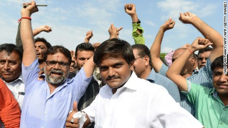 """Hardik Patel (C), an organiser of the Patidar community, gathers with group members for a rally demanding """"Other Backward Class"""" (OBC) status in Ahmedabad on August 23, 2015. OBC members have urged the Gujarat government not to grant the Patel, or Patidar, community the status, which grants official protection of the members' social and educational development. AFP PHOTO / Sam PANTHAKY        (Photo credit should read SAM PANTHAKY/AFP/Getty Images)"""