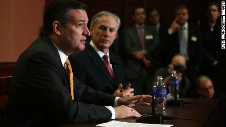 Republican presidential candidate Sen. Ted Cruz (R-TX) (L) and Texas Governor Greg Abbott (R) participate in a news conference December 8, 2015 on Capitol Hill in Washington, DC.