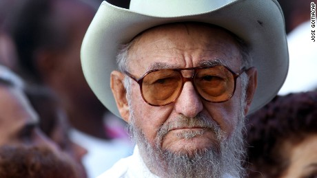 FILE - This Dec. 22, 2001 file photo shows Ramon Castro during a rally, in Havana, Cuba. Castro, a lifelong rancher and farmer who bore a strong physical resemblance to his younger brother, Cuban revolutionary leader Fidel Castro, died Tuesday, Feb. 23, 2016, state media announced. He was 91. ( AP Photo/Jose Goitia, File)