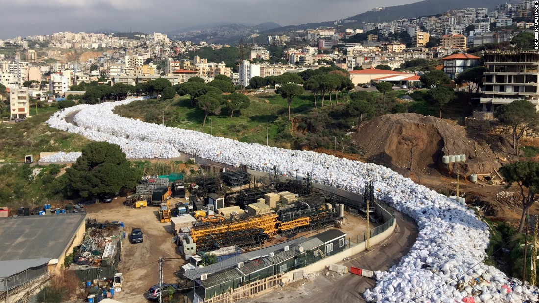 Piles of waste resemble a river of garbage in the Lebanese capital, Beirut, on Wednesday, February 24. Lebanon canceled a plan to export its waste to Russia, sending the country's ongoing waste crisis back to square one as mountains of trash choke the streets.