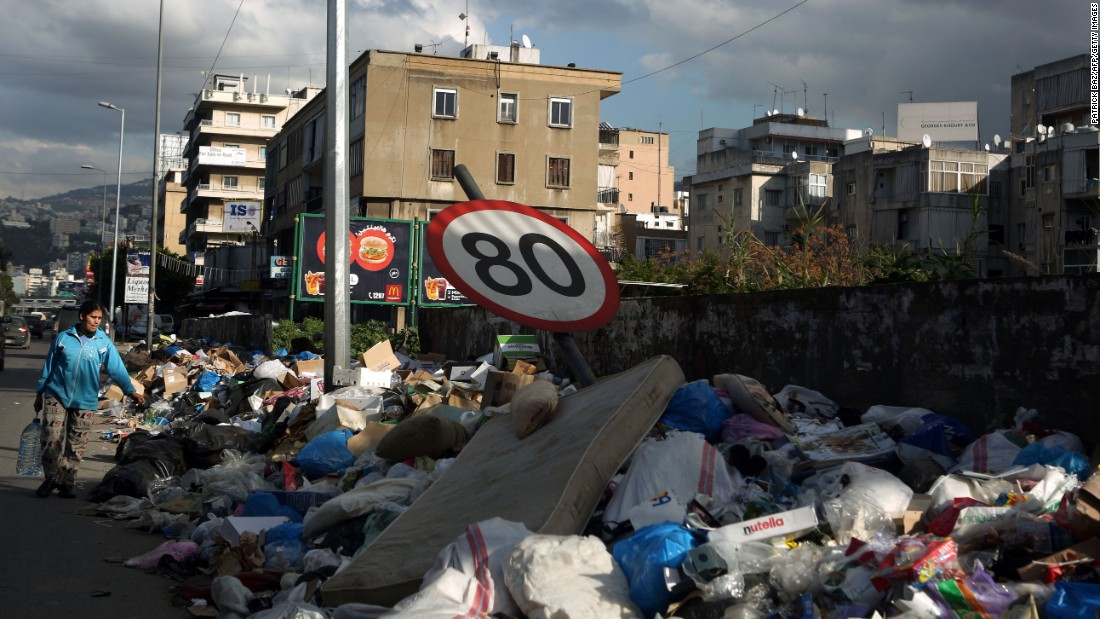 A traffic sign bends under the weight of garbage piling up on the side of a road north of the Lebanese capital on January 15.