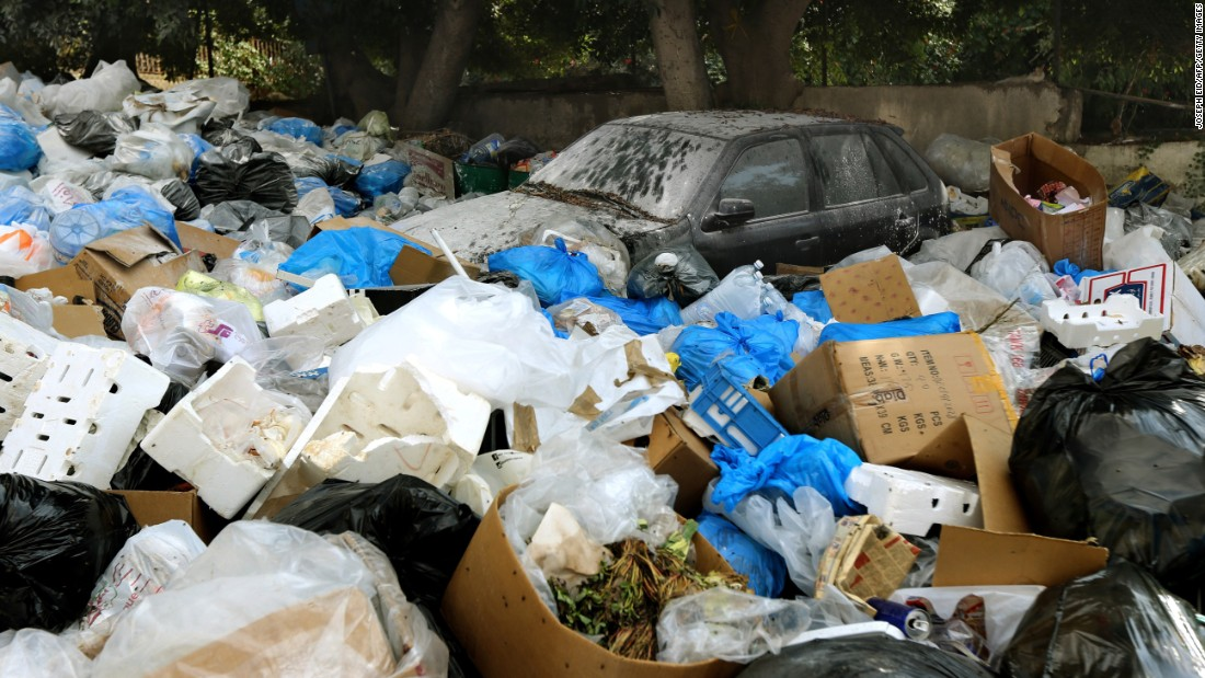 Garbage surrounds a car in Baabda, east of the Lebanese capital, on August 24.