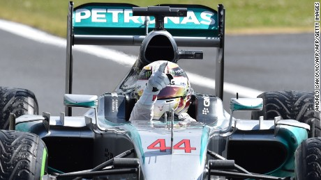 Mercedes AMG Petronas F1 Team's British driver Lewis Hamilton raises his finger after winning the British Formula One Grand Prix at the Silverstone circuit in Silverstone on July 5, 2015.  AFP PHOTO / ANDREJ ISAKOVIC        (Photo credit should read ANDREJ ISAKOVIC/AFP/Getty Images)