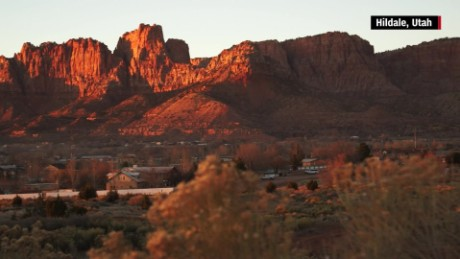 Hildale, Utah, and Colorado City, Arizona, are nestled at the foot of breathtaking red rock cliffs.