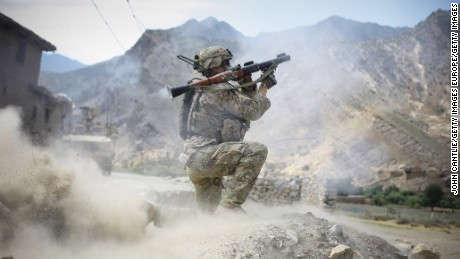 PECH VALLEY, AFGHANISTAN - JUNE 22:  A US soldier from 2-12 Infantry Regiment out of Colorado Springs fires an Afghan rocket-propelled grenade during a firefight with insurgents on June 22, 2012 in the Pech Valley, Afghanistan. As the NATO draw-down gathers pace in eastern Afghanistan, the Afghan National Army have voiced concern that without US re-supply, they won't be able to secure the region against insurgents.  (Photo by John Cantlie/Getty Images)
