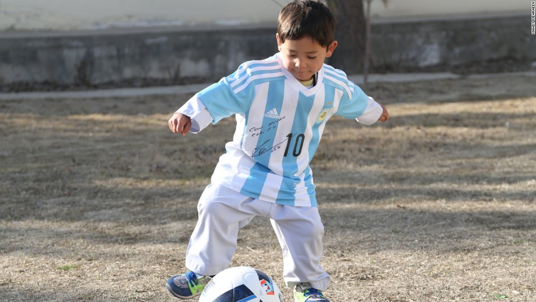 Murtaza shows off his skills with his Messi-autographed football.