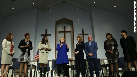 Clinton speaks during an event with five mothers who lost their children to gun violence at the Central Baptist Church February 23, 2016 in Columbia, South Carolina. Also pictured are (L-R) Lucy McBath, mother of Jordan Davis; Maria Hamilton, mother of Dontre Hamilton; Sybrina Fulton, mother of Trayvon Martin; former U.S. Rep. Gabby Giffords; Mark Kelly; Gwen Carr, mother of Eric Garner; Geneva Reed-Veal, mother of Sandra Bland.
