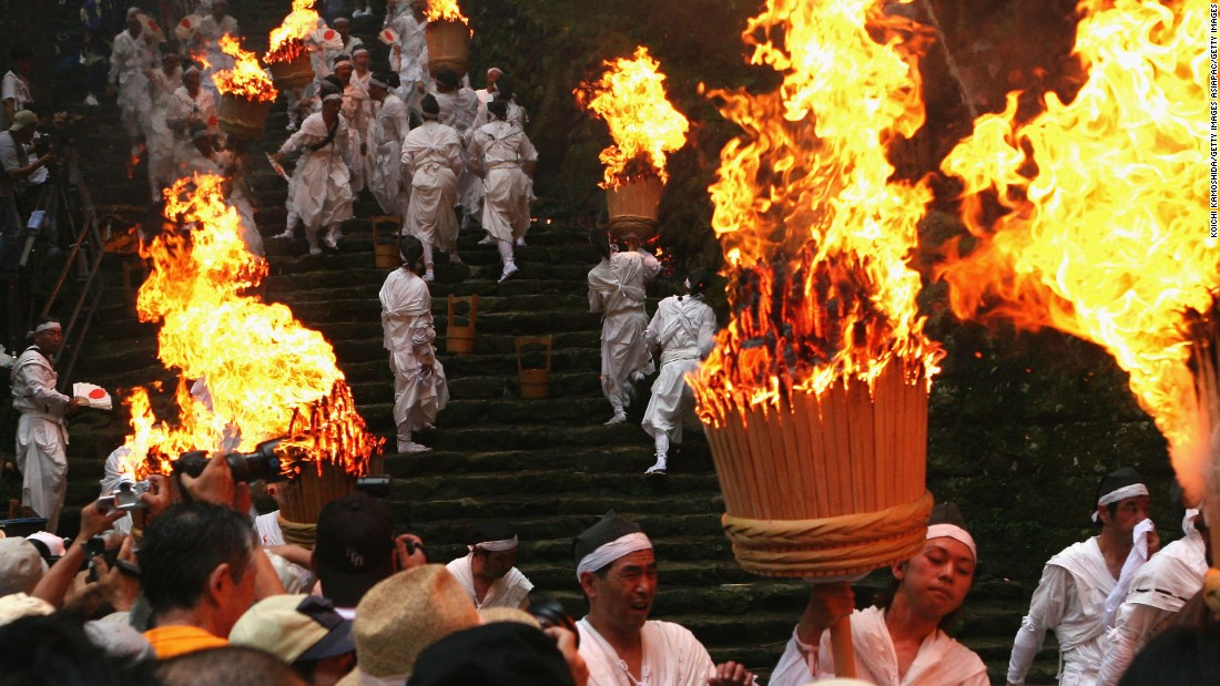 Nothing's quite as thrilling as watching hundreds of young Japanese men rush down a steep staircase with 50-kilo torches.