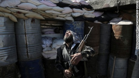 A Syrian rebel fighter from the Failaq al-Rahman brigade mans a position on the frontline against regime forces in the town of Arbin in the eastern Ghouta region on the outskirts of the capital Damascus on February 26, 2016.  A partial ceasefire between Syria's regime forces and non-jihadist rebel fighters is due to take effect at midnight (2200 GMT) local time.  / AFP / AMER_ALMOHIBANY AND AMER ALMOHIBANY        (Photo credit should read AMER_ALMOHIBANY,AMER ALMOHIBANY/AFP/Getty Images)