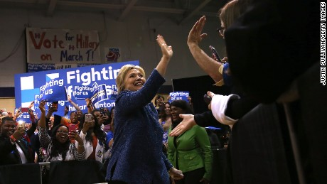"""Democratic presidential candidate former Secretary of State Hillary Clinton greets supporters during a """"Get Out The Vote"""" at Miles College on February 27, 2016 in Fairfield, Alabama."""