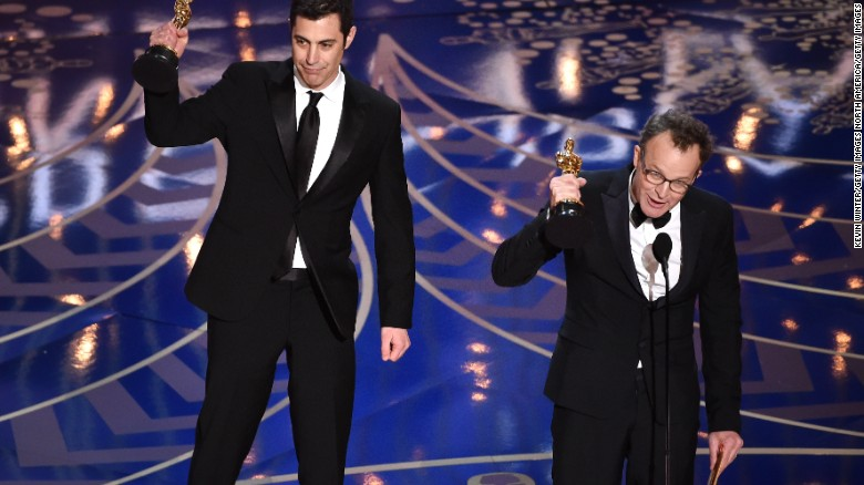 HOLLYWOOD, CA - FEBRUARY 28:  Screenwriter Josh Singer (L) and screenwriter-director Tom McCarthy accept the Best Original Screenplay award for 'Spotlight' onstage during the 88th Annual Academy Awards at the Dolby Theatre on February 28, 2016 in Hollywood, California.  (Photo by Kevin Winter/Getty Images)