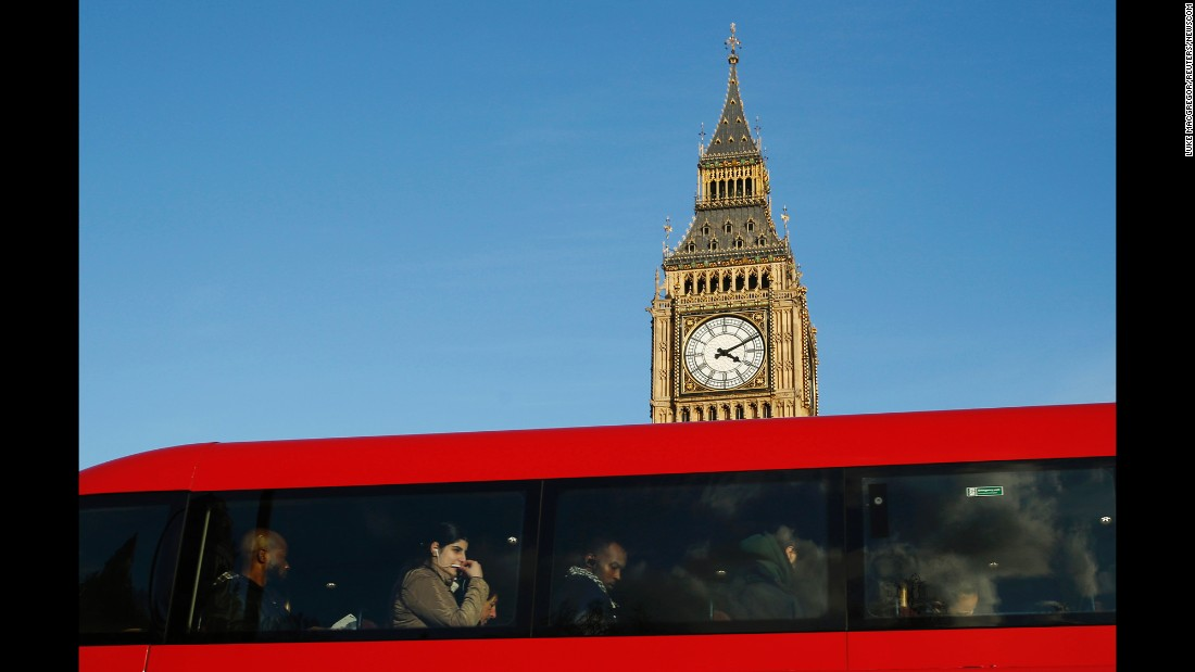 Two London icons: a red double-decker bus and Big Ben bell tower at the Palace of Westminster, the UK's seat of government.