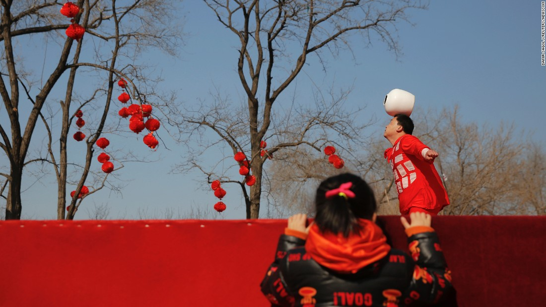 Acrobats perform in Beijing's Longtan Park during Lunar New Year celebrations in February. This is the Year of the Monkey.