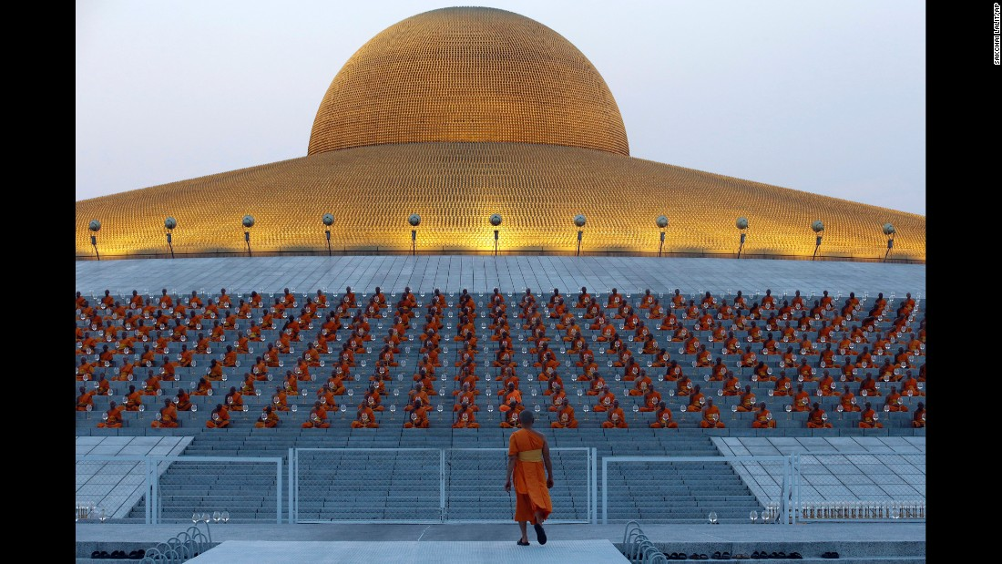 Buddhist monks gather outside Wat Phra Dhammakaya temple as part of Makha Bucha ceremonies. Makha Bucha marks the anniversary of Buddha's sermon that established the basic tenets of the Sangha monastic order.