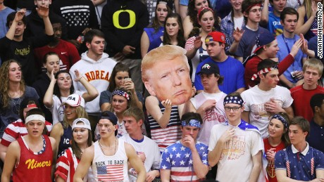 "Fans of Andrean High School held up a picture of GOP presidential candidate Donald Trump and shouted chants like ""Build a Wall"" during a basketball game against Bishop Noll Institute on Friday in Merrillville, Indiana."