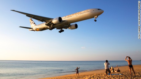 """This picture was taken end-December 2015 at Phuket International Airport,"" says Singaporean plane-spotter Kok Chwee Sim.  ""When the planes land from the west, they swoop low over the beach and this is a thrill for beachcombers and aviation spotters. The plane depicted here is a B777-300ER of Etihad Airways."""
