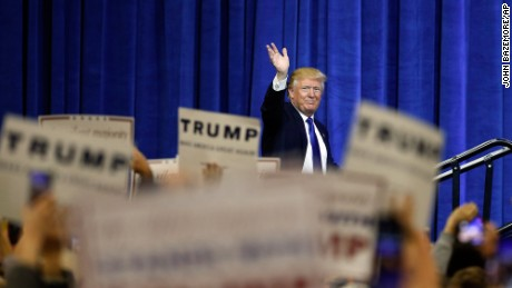 Republican presidential candidate Donald Trump waves as he steps on stage to speak at a rally Tuesday, March 1, 2016, in Louisville, Ky. (AP Photo/John Bazemore)