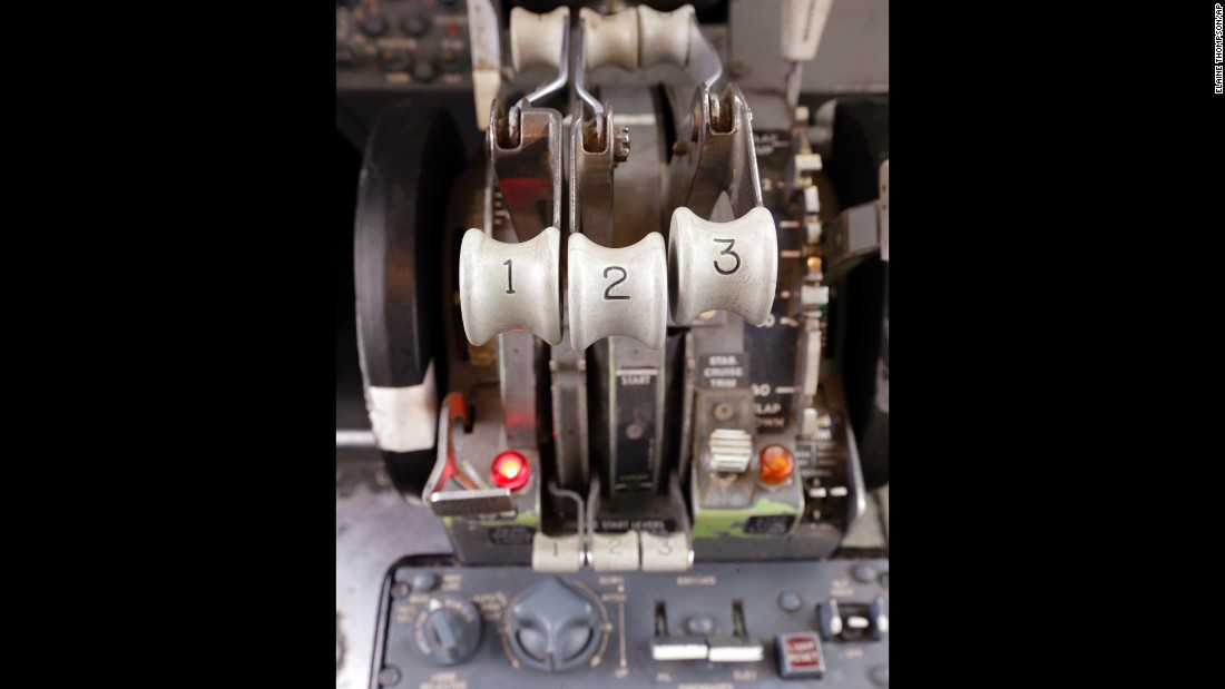 "This throttle controls the 727's three engines. Flying aboard a so-called ""three-holer"" nowadays is a rare experience. More efficient twin-engine airliners have become dominant in the industry."