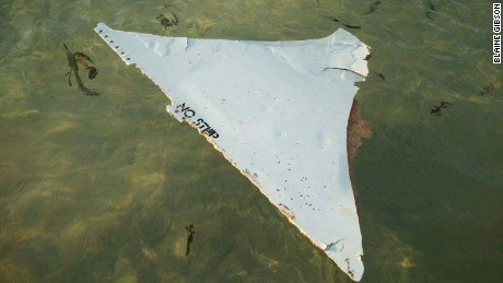 A Mozambican official told CNN the plane part, measuring 35 inches by 22 inches, was discovered by an American tourist, Blaine Gibson, and a local fisherman on a sandbank in Mozambique.