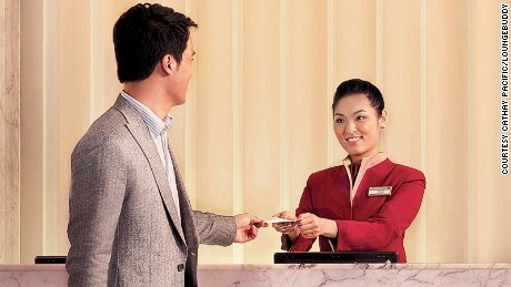 Cathay Pacific Hong Kong Lounge. Airline crew greeting customer