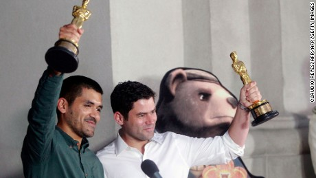 Chilean filmmakers of  'Bear Story' Gabriel Osorio (L) and Patricio Escala, hold their Academy Award for best animated short film, as they pose for the press after a meeting with Chilean President Michelle Bachelet (out of frame) at La Moneda presidential Palace in Santiago, on  March 1, 2016. It is the first time a Chilean wins an Academy Award. AFP PHOTO/ CLAUDIO REYES / AFP / Claudio Reyes        (Photo credit should read CLAUDIO REYES/AFP/Getty Images)