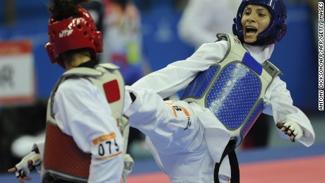 Noh Eun-sil of South Korea (L) fights Raheleh Asemani of Iran in the women's under 62 kg Taekwondo final at the Guangdong Stadium in Guangzhou during the 16th Asian Games on November 19, 2010.  Noh defeated Asemani 14:2 to take gold.     AFP PHOTO / Antony DICKSON (Photo credit should read ANTONY DICKSON/AFP/Getty Images)