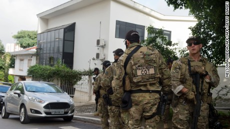 Federal police officers are deployed at the Lula Institute headquarters in Sao Paulo, Brazil on March 04, 2016. Police searched the home of Brazil's powerful ex-president Luiz Inacio Lula da Silva and detained him for questioning Friday in a probe into a huge corruption scheme. Agents searched his house in Sao Paulo, the offices of the Lula Institute, and houses of family members, Jose Chrispiniano, a spokesman for Lula and his institute, told AFP.AFP PHOTO / NELSON ALMEIDA / AFP / NELSON ALMEIDA        (Photo credit should read NELSON ALMEIDA/AFP/Getty Images)