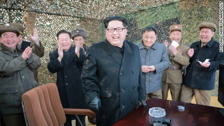 Photo released by North Korean state newspaper Rodong Shimbun of Kim Jong Un giving field guidance at the multiple rocket launcher test scene.