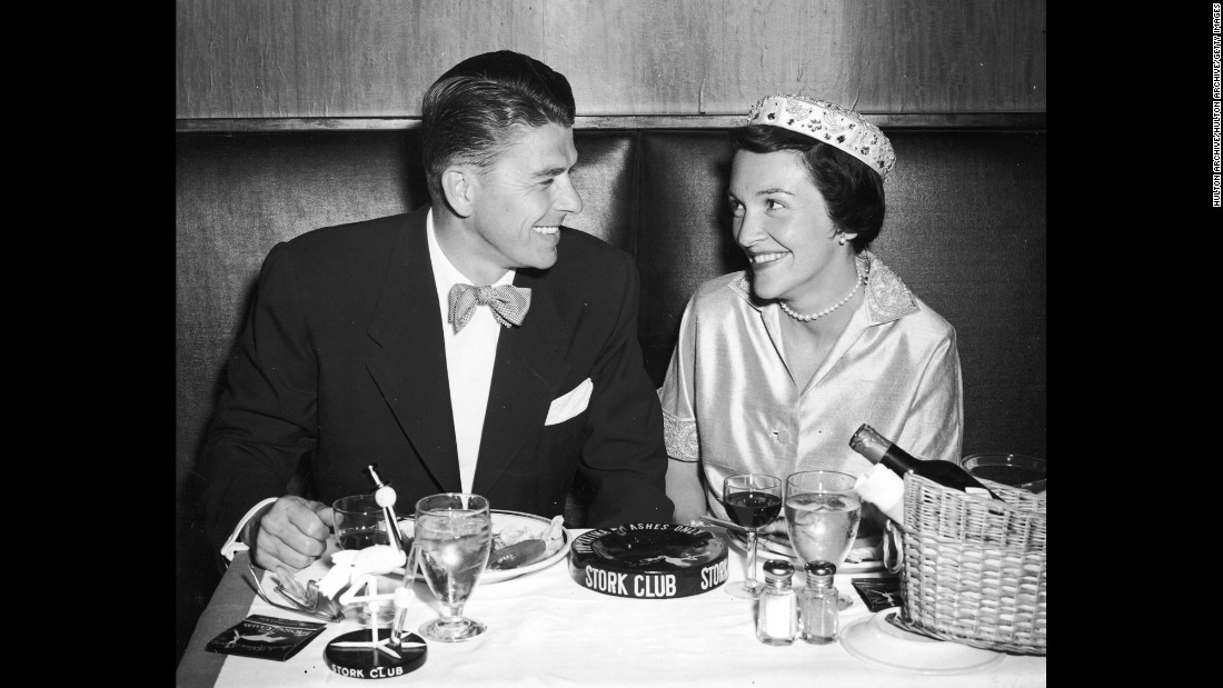 Ronald and Nancy Reagan smile as they have their honeymoon dinner at the Stork Club in New York City in 1952.