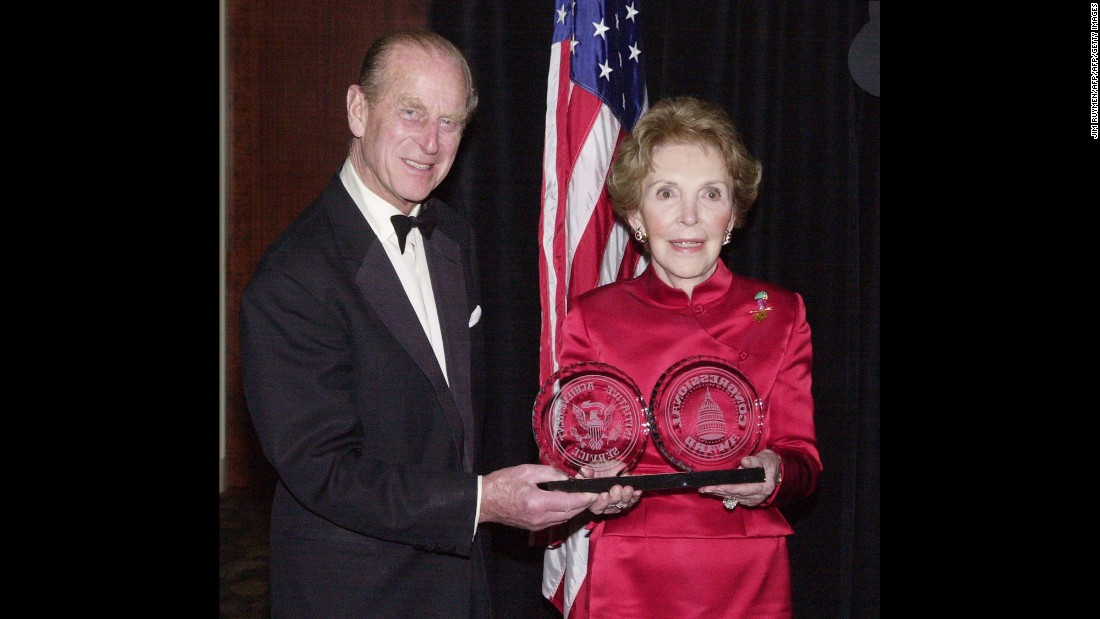 Nancy Reagan poses with the Leadership Award she received from Prince Philip, Duke of Edinburgh, on March 15, 2000, at the Beverly Hills Hotel in Beverly Hills, Caifornia. She was honored by the Congressional Award Foundation for her efforts as first lady in the fight against youth drug abuse both in the United States and around the world.