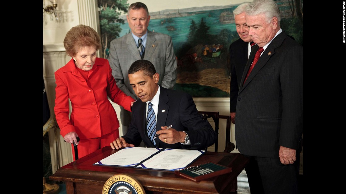 "Reagan, from left, Rep. Dana Rohrabacher, Sen. Richard Lugar and Rep. Elton Gallegly watch President Barack Obama sign a bill on June 2, 2009, in Washington. Obama signed the ""Ronald Reagan Centennial Commission Act"" to honor Ronald Reagan on his 100th birth anniversary in 2011."
