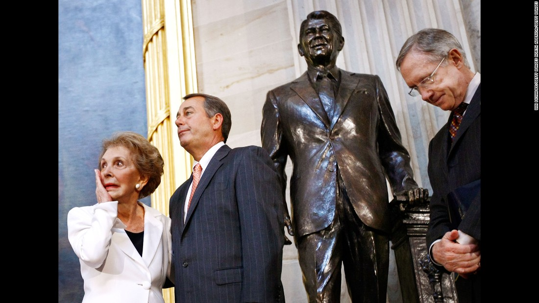 Reagan wipes away a tear after the unveiling of a statue of former President Ronald Reagan in the Rotunda of the U.S. Capitol on June 3, 2009. Also pictured, from left, are House Minority Leader John Boehner and Senate Majority Leader Harry Reid.