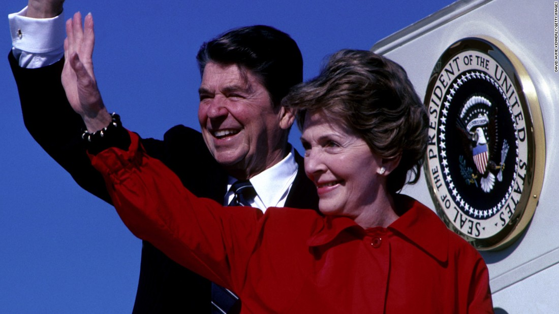 First lady Nancy Reagan stands next to her husband, President Ronald Reagan, as they wave from the steps of Air Force One in December 1981. The first lady died at her home in Los Angeles of congestive heart failure, according to her spokeswoman, Joanne Drake of the Ronald Reagan Presidential Library. She was 94.